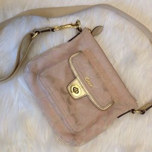 pretty coach soft pink with gold mini crossbody